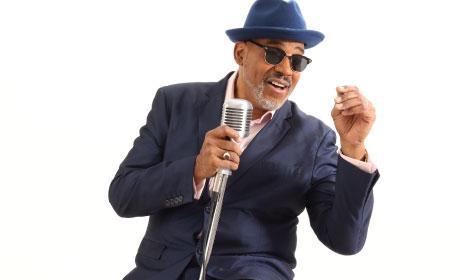 Male jazz artist on mic