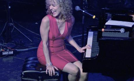 Judy Carmichael at a piano laughing