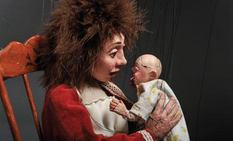 Mother holding her child in rocker puppet