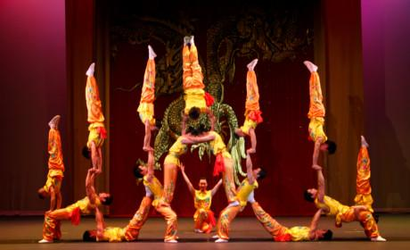 Acrobats Doing Acrobatic Movements on Stage