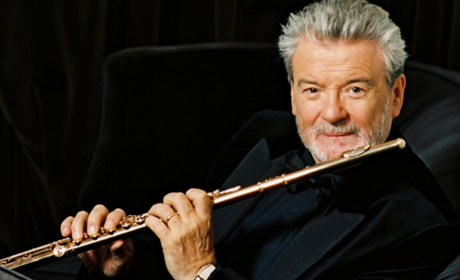 Man Holding Flute Contentedly