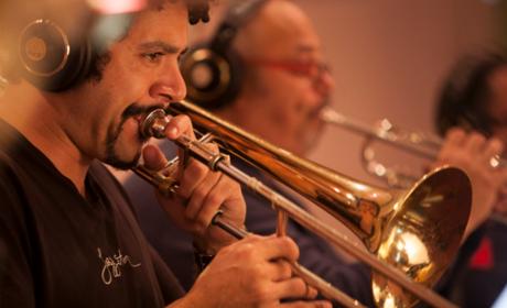 Men Playing Trumpets