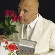 Rex Havens with roses and jewelry in a box