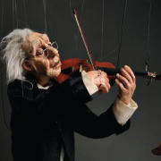 Old Man Marionette playing a violin