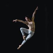 Photo of man elegantly dancing in the air