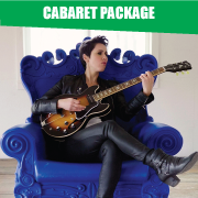 Woman playing electric guitar sitting in blue chair